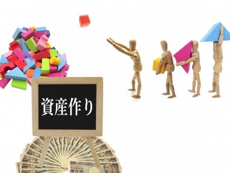 人形がブロックを投げ積み上げている画像